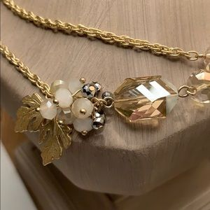 Long gold necklace.